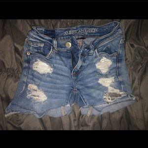 • AEO mid rise distressed denim shorts